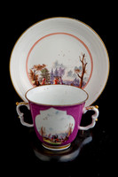 P050A - TWO MEISSEN PUCE-GROUND TWO-HANDLED BEAKERS AND A SAUCER