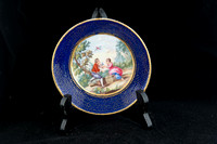P059A - A SEVRES GILT TAILLANDIER BLUE-GROUND CUP AND SAUCER (GOBELET 'LITRON' ET SA SOUCOUPE, 3EME