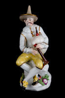 P106 - MEISSEN FIGURE OF HARLEQUIN PLAYING BAGPIPES