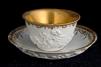 P093 - MEISSEN GILT-WHITE TEABOWL AND A SAUCER