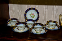 P202 - FIVE ENGLISH BLUE-GROUND TEACUPS AND SAUCERS