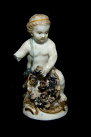 P197 - A MEISSEN FIGURE OF A FEMALE PUTTO